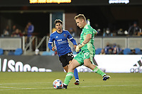 SAN JOSE, CA - MAY 22: Cade Cowell #44 of the San Jose Earthquakes watches as Tim Melia #29 of Sporting Kansas City clears a ball during a game between Sporting Kansas City and San Jose Earthquakes at PayPal Park on May 22, 2021 in San Jose, California.