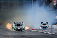Mar. 11, 2012; Gainesville, FL, USA; NHRA funny car driver Alexis DeJoria (left) defeats John Force in the first round during the Gatornationals at Auto Plus Raceway at Gainesville. Mandatory Credit: Mark J. Rebilas-