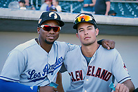 Yusniel Diaz (21), prospect in the Los Angeles Dodgers organization, and Tyler Krieger (15), of the Cleveland Indians organization, both members of the Glendale Desert Dogs, pose for a photo before an Arizona Fall League game against the Mesa Solar Sox on October 28, 2017 at Sloan Park in Mesa, Arizona. The Solar Sox defeated the Desert Dogs 9-6. (Zachary Lucy/Four Seam Images)