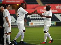 Adrian Forbes of Swansea (R) is substituted by John Williams (C) during the Alan Tate Testimonial Match, Swansea City Legends v Manchester United Legends at the Liberty Stadium, Swansea, Wales, UK