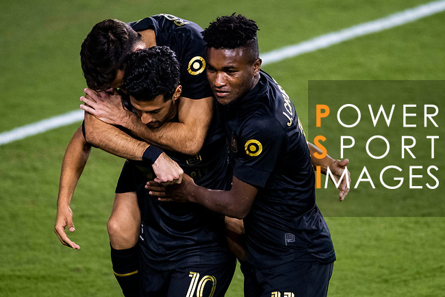 Carlos Vela of Los Angeles FC (USA) is congratulated by teams mates after scoring a goal against Club America (MEX) during their CONCACAF Champions League Semi Finals match at the Orlando's Exploria Stadium on 19 December 2020, in Florida, USA. Photo by Victor Fraile / Power Sport Images