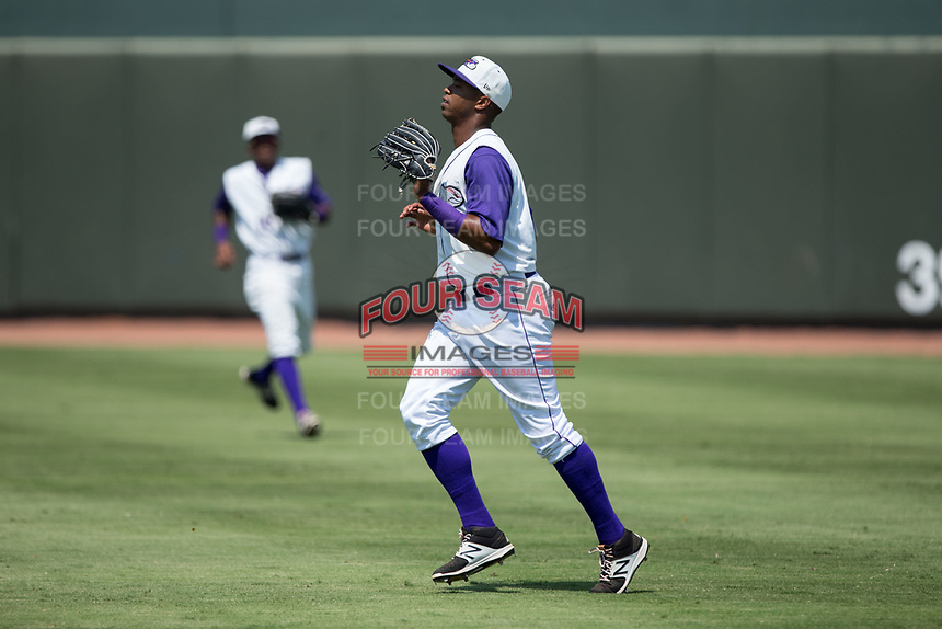 Winston-Salem Dash right fielder Eloy Jimenez (27) catches a fly ball during the game against the Potomac Nationals at BB&T Ballpark on August 6, 2017 in Winston-Salem, North Carolina.  The Nationals defeated the Dash 4-3 in 10 innings.  (Brian Westerholt/Four Seam Images)