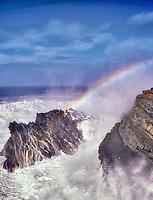 Rainbow from crashing storm waces. Shore Acres State Park. Oregon