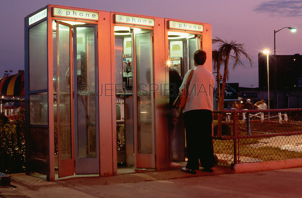 Original Image Photographed in August 1981 0n Ektachrome Transparency Film.<br /> <br /> Telephone Booth on the Boardwalk at Dusk with Miniature Golf Course in the Background at the New Jersey Shore, Asbury Park, New Jersey USA