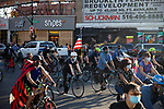 Bikers ride on Flatbush Avenue as people gather in the streets in celebration after former Vice President Joe Biden was declared the winner of the 2020 presidential election between U.S. President Donald Trump and Biden on November 7, 2020 in New York City.  Photograph by Michael Nagle