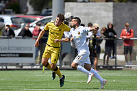Mario Barcia of Team Wellington competes for the ball with Riley Bidois of the Wellington Phoenix during the SPS Handa Men's Premiership - Wellington Phoenix v Team Wellington at Fraser Park, Wellington on Saturday 14 November 2020.<br /> Copyright photo: Masanori Udagawa /  www.photosport.nz
