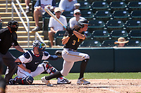 Pittsburgh Pirates Cole Tucker (3) bats during a Major League Spring Training game against the Minnesota Twins on March 16, 2021 at Hammond Stadium in Fort Myers, Florida.  Also shown is umpire Fieldin Culbreth and catcher Mitch Garver.  (Mike Janes/Four Seam Images)
