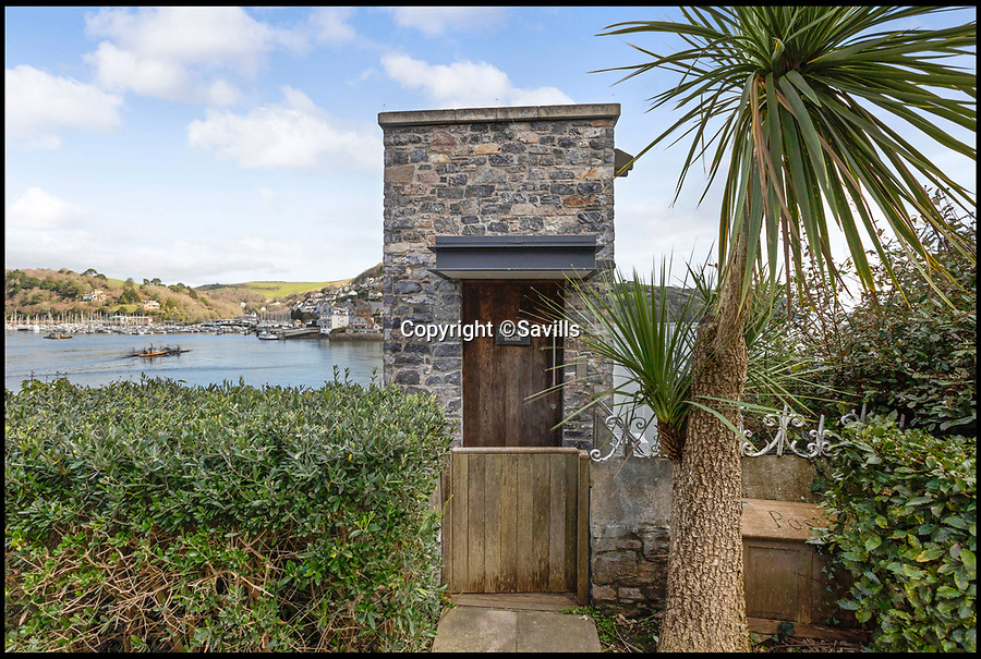 BNPS.co.uk (01202 558833)<br /> Pic: Savills/BNPS<br /> <br /> Unassuming entrance...<br /> <br /> An award-winning waterfront home that has spectacular seaside views has gone on the market for £5m.<br /> <br /> The aptly named River House sits right on the Dart Estuary in Devon and has been so cleverly designed there is a glass floor in the master bedroom that looks down on the water.<br /> <br /> Its main living areas have floor-to-ceiling bi-fold doors and glass Juliet balconies to give the property a feel of Venice rather than Devon.<br /> <br /> Interestingly, the five bedroom house is being sold along with a nearby two bedroom town house that is owned by the same vendors.