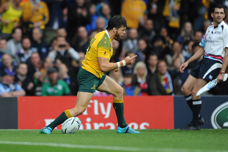 Adam Ashley-Cooper of Australia celebrates scoring the opening try during the Quarter Final of the Rugby World Cup 2015 between Australia and Scotland - 18/10/2015 - Twickenham Stadium, London<br /> Mandatory Credit: Rob Munro/Stewart Communications