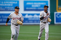 Wisconsin Timber Rattlers outfielders Leugim Castillo (27) and Korry Howell (36) jog off the field between innings of a Midwest League game against the Lansing Lugnuts at Cooley Law School Stadium on May 1, 2019 in Lansing, Michigan. Wisconsin defeated Lansing 2-1 in the second game of a doubleheader. (Zachary Lucy/Four Seam Images)