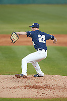 Wingate Bulldogs relief pitcher Alex Rodriguez (22) in action against the Concord Mountain Lions at Ron Christopher Stadium on February 1, 2020 in Wingate, North Carolina. The Bulldogs defeated the Mountain Lions 8-0 in game one of a doubleheader. (Brian Westerholt/Four Seam Images)