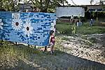 UKRAINE, Mariupol: Little girl at the beach is waiting after her parents.<br /> <br /> UKRAINE, Mariupol: Une petite fille à la plage attend ses parents.