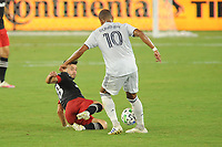 WASHINGTON, DC - AUGUST 25: Teal Bunbury #10 of New England Revolution battles for the ball with Felipe Martins #18 of D.C. United during a game between New England Revolution and D.C. United at Audi Field on August 25, 2020 in Washington, DC.