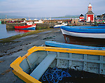 County Kerry, Ireland          <br /> Colorful wooden boats and clock tower of the Knights Town harbor, Valencia island, off the Iveragh Peninsula.