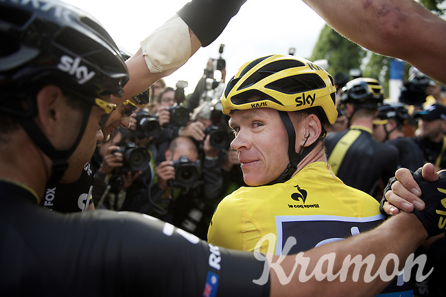 """As teammates celebrate around him and press photographers mob the 2015 Tour winner, Chris Froome (GBR/SKY) turnes around and stares in my lens for a second just after having crossed the finish line. """"Got it!"""" <br /> Beautiful quiet millimoment in a sea of chaos around us.<br /> <br /> stage 21: Sèvres - Champs Elysées (109km)<br /> 2015 Tour de France"""