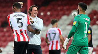 Brentford Manager, Thomas Frank, celebrates their victory with goalscorer, Ethan Pinnock, at the final whistle during Brentford vs Charlton Athletic, Sky Bet EFL Championship Football at Griffin Park on 7th July 2020