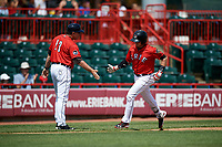 Erie SeaWolves third baseman Kody Eaves (22) is congratulated as he rounds third base after hitting a home run in the bottom of the second inning during a game against the Reading Fightin Phils on May 18, 2017 at UPMC Park in Erie, Pennsylvania.  Reading defeated Erie 8-3.  (Mike Janes/Four Seam Images)