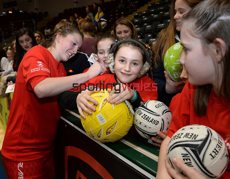 Wales Bethan Dyke signs an autograph<br /> <br /> Swansea University International Netball Test Series: Wales v New Zealand<br /> Ice Arena Wales<br /> 08.02.17<br /> ©Ian Cook - Sportingwales