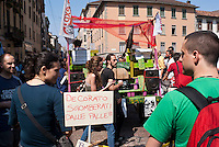 Milano, Mayday Parade, manifestazione del 1. maggio di gruppi e organizzazioni di sinistra contro il lavoro precario. Un cartello contro il vice sindaco De Corato --- Milan, Mayday Parade, 1st of May manifestation of leftist groups and organizations against temporary work. A placard against deputy mayor De Corato