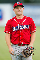 Chad Carman (21) of the Lakewood BlueClaws warms up in the outfield prior to the game against the Kannapolis Intimidators at CMC-Northeast Stadium on August 13, 2013 in Kannapolis, North Carolina.  The Intimidators defeated the BlueClaws 12-8.  (Brian Westerholt/Four Seam Images)