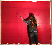 Wall gets painted red during construction of popcorn store in Uptown Westerville.