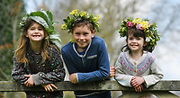 BNPS.co.uk (01202 558833)<br /> Pic: ZacharyCulpin/BNPS <br /> <br /> Weather input - <br /> <br /> Crowning glories: Dorset Flower Farmers, the Priestley family perfect their flower crown-making ahead of Garden Day on Sunday 9th May, the nationwide celebration of the benefits of gardens for health and wellbeing.  <br /> <br /> Pictured: Siblings, Isadora, 7, Milo, 9, and Arabella Priestley, 5 show off their flower crowns in the garden<br /> <br /> Garden Day will be back for a third successive year on Sunday, 9th May 2021 to celebrate outdoor and indoor garden spaces. The nationwide  movement is calling on plant-lovers to make a flower crown, and share their plant spaces with family and<br /> friends