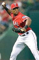 Texas Rangers third baseman Adrian Beltre (29) makes a throw to first base against the Oakland Athetics in American League baseball on May 11, 2011 at the Rangers Ballpark in  Arlington, Texas. (Photo by Andrew Woolley / Four Seam Images)