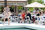 Guests watch models wearing fashions available at Tootsie's at the River Oaks Tennis Luncheon Wednesday April 08,2009.(Dave Rossman/For the Chronicle)