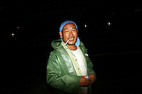 CHINA. Beijing. A migrant worker near the Olympic stadium. 2008