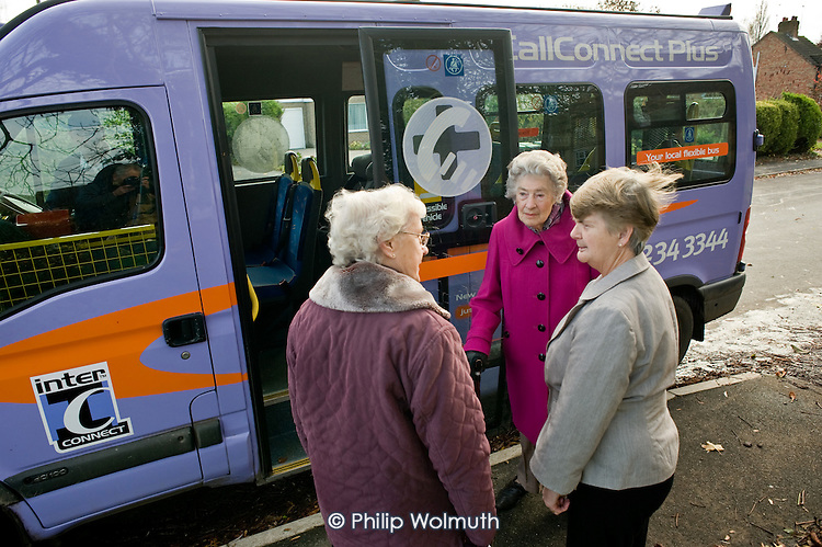"""Three elderly women with a CallConnect bus in the village of Ewerby, Lincolnshire.   The innovative bus-on-demand service features in the Rural Media Company's """"Over the Hill?"""" project."""