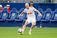 CARSON, CA - APRIL 25: Andrew Gutman  #5 of the New York Red bulls passes off the ball during a game between New York Red Bulls and Los Angeles Galaxy at Dignity Health Sports Park on April 25, 2021 in Carson, California.