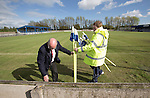Vauxhall Motors FC 0 Solihull Moors 2, 26/04/2014. Rivacre Park, Conference North. Club officials gathering corner flags for the last time after Vauxhall Motors played Solihull Moors at Rivacre Park in the final Conference North fixture of the season. It was to be the last match for the Ellesmere Port-based home club, named after the giant car factory in the town, who have resigned from the professional pyramid system to return to local amateur football due to spiralling costs and low attendances. Their final match resulted in a 2-0 home defeat, watched by a crowd of only 215. Photo by Colin McPherson.