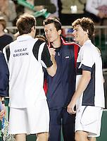 7-4-07, England, Birmingham, Tennis, Daviscup England-Netherlands, Tim Henman(m)congretulates his teammates Greg Rusedski and Jamie Murray after winning the dicisive doubles