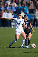 Cary, North Carolina - Sunday December 6, 2015: Taylor Racioppi (7) of the Duke Blue Devils battles for the ball with Kaleigh Riehl (3) of the Penn State Nittany Lions during second half action at the 2015 NCAA Women's College Cup at WakeMed Soccer Park.  The Nittany Lions defeated the Blue Devils 1-0.