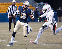 Pitt wide receiver Kevin Weatherspoon (88) tries to avoid a tackle from Miami defensive back Artie Burns (1).The Miami Hurricanes defeated the Pitt Panthers 41-31 at Heinz Field, Pittsburgh, Pennsylvania on November 29, 2013.