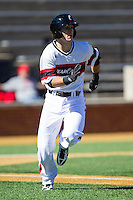 Connor McVey (18) of the Cincinnati Bearcats hustles down the first base line against the Radford Highlanders at Wake Forest Baseball Park on February 22, 2014 in Winston-Salem, North Carolina.  The Highlanders defeated the Bearcats 6-5.  (Brian Westerholt/Four Seam Images)