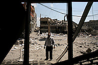 Saida, Lebanon, July 19 2006.Oussama L'gosh, 36, evaluates the damage done to his shop by the Israeli Air Force bombardment of a group of civilian houses and shops in the southern outskirts of Saida, near the coastal road. There was no military or strategic target in the area.