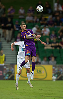 27th March 2021; HBF Park, Perth, Western Australia, Australia; A League Football, Perth Glory versus Newcastle Jets; Andy Keogh of Perth Glory wins the header against Matthew Millar of the Newcastle Jets