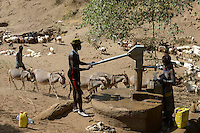 ETHIOPIA, Southern Nations, Lower Omo valley, Kangaten, village Kakuta, Nyangatom tribe, water pump at dry river Kibish / AETHIOPIEN, Omo Tal, Kangaten, Dorf Kakuta, Nyangatom Hirtenvolk, Wasserpumpe am trocknen Fluss Kibish