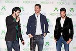 Real Madrid´s Sergio Ramos (C) and Barcelona´s Cesc Fabregas (R) attend the new Xbox One presentation in Madrid, Spain. November 21, 2013. (ALTERPHOTOS/Victor Blanco)