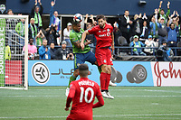 SEATTLE, WA - NOVEMBER 10: Roman Torres #29 of the Seattle Sounders FC and Omar Gonzalez #44 of Toronto FC challenge for a header during a game between Toronto FC and Seattle Sounders FC at CenturyLink Field on November 10, 2019 in Seattle, Washington.
