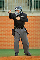 Home plate umpire Josh Reep makes a strike call during the game between the Delaware State Hornets and the Charlotte 49ers at Robert and Mariam Hayes Stadium on February 15, 2013 in Charlotte, North Carolina.  The 49ers defeated the Hornets 13-7.  (Brian Westerholt/Four Seam Images)