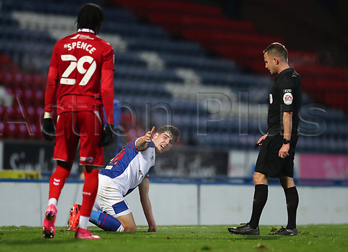 3rd November 2020; Ewood Park, Blackburn, Lancashire, England; English Football League Championship Football, Blackburn Rovers versus Middlesbrough; Joseph Rankin-Costello of Blackburn Rovers complains to the referee after he is brought down by Djed Spence of Middlesbrough