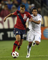 Timothy Chandler(21) of the USA MNT pushes away from Marcelo Alejandro Estigambia(18) of Paraguay during an international friendly match at LP Field, in Nashville, TN. on March 29, 2011. Paraguay won 1-0.