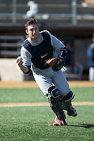 Richmond Spiders catcher Kyle Schmidt (37) picks up the baseball during the game against the Wake Forest Demon Deacons at David F. Couch Ballpark on March 6, 2016 in Winston-Salem, North Carolina.  The Demon Deacons defeated the Spiders 17-4.  (Brian Westerholt/Four Seam Images)