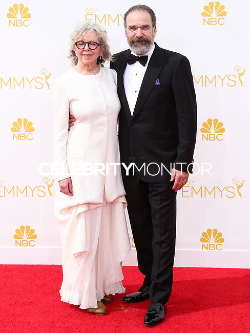 LOS ANGELES, CA, USA - AUGUST 25: Kathryn Grody and Mandy Patinkin arrive at the 66th Annual Primetime Emmy Awards held at Nokia Theatre L.A. Live on August 25, 2014 in Los Angeles, California, United States. (Photo by Celebrity Monitor)