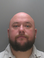"""Pictured: Undated custody picture of Stephen Jones<br />Re: Ten people have been sentenced for defrauding four pensioners from north Wales out of hundreds of thousands of pounds for non existent, poor or unnecessary building work.<br />They defrauded one person out of £650,000 and another victim was the late grandmother of actor Jude Law.<br />Meinwen Parry, 89, who died in March 2015, had paid out £60,000 for work which should have cost about £3,500.<br />Sentencing took place at Caernarfon Crown Court on Friday.<br />Judge Huw Rees said the level of greed was outstanding.<br />Stephen Jones, 38, from Llangefni, Anglesey, targeted Ms Parry's home at Bangor, Gwynedd.<br />He and Bedwyr Roberts, 35, from Bangor, also took £650,000 in life-savings from cancer patient John Bates between 2009-16, the court heard.<br />They were jailed for eight and six years respectively.<br />The offences centred around """"extortionate"""" costs for roofing and building work undertaken in the Anglesey, Bangor and Conwy areas, said North Wales Police. The other defendants sentenced were:"""