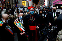 NEW YORK, NEW YORK - MARCH 17: The Cardinal Timothy Dolan (C) greets people attending St. Patrick's Day parade on March 17, 2021 in New York. St. Patrick's Day Parade organizers say they postpone the celebration, but a small group marched to preserve the tradition. (Photo by John Smith/VIEWpress)