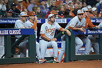 Texas Longhorns student assistant Huston Street (center) watches from the dugout during the game against the LSU Tigers in game three of the 2020 Shriners Hospitals for Children College Classic at Minute Maid Park on February 28, 2020 in Houston, Texas. The Tigers defeated the Longhorns 4-3. (Brian Westerholt/Four Seam Images)