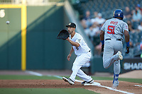 Charlotte Knights first baseman Seby Zavala (5) waits for a throw as Socrates Brito (51) of the Buffalo Bisons hustles down the line at BB&T BallPark on July 24, 2019 in Charlotte, North Carolina. The Bisons defeated the Knights 8-4. (Brian Westerholt/Four Seam Images)